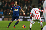Daley Blind of Manchester Utd in action (l). Premier league match, Stoke City v Manchester Utd at the Bet365 Stadium in Stoke on Trent, Staffs on Saturday 21st January 2017.<br /> pic by Andrew Orchard, Andrew Orchard sports photography.