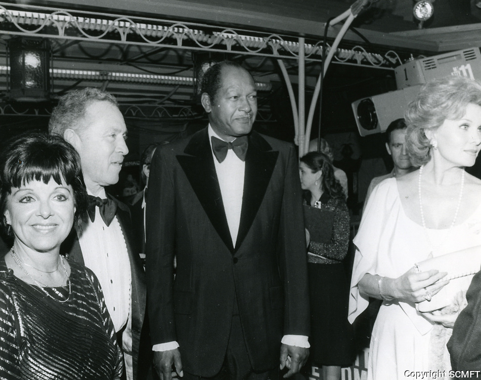 """1979 (L to R) Councilwoman Peggy Stevenson, Ted Mann, Mayor Tom Bradley and Rhonda Fleming at the movie premiere of """"Hurricane"""" at Mann's Chinese Theater"""