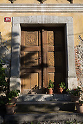 A stone and wood doorway of a building built in 1884, in a rural Slovenian village, on 19th June 2018, in Bohinjska Bela, Bled, Slovenia.