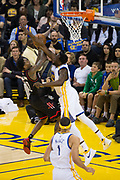Golden State Warriors forward Draymond Green (23) blocks a shot by Houston Rockets guard Lou Williams (12) at Oracle Arena in Oakland, Calif., on March 31, 2017. (Stan Olszewski/Special to S.F. Examiner)