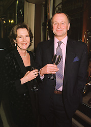 MR & MRS SIMON PARKER BOWLES he is the former brother in law of Camilla Parker Bowles, at a party in London on 29th April 1998.MHG 23