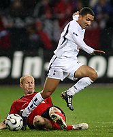 Photo: Paul Thomas.<br /> Bayer Leverkusen v Tottenham Hotspur. UEFA Cup. 23/11/2006.<br /> <br /> Aaron Lennon (White) of Spurs gets tackled by Sergej Barbarez.