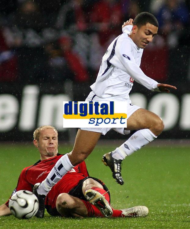 Photo: Paul Thomas.<br /> Bayer Leverkusen v Tottenham Hotspur. UEFA Cup. 23/11/2006.<br /> <br /> Aaron Lennon (White) of Spurs gets tackled by Sergej Barbarez.