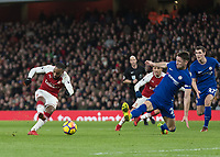 Football - 2017 / 2018 Premier League - Arsenal vs. Chelsea<br /> <br /> Alexandre Lacazette (Arsenal FC) turns and fires towards the Chelsea goal past the outstretched Gary Cahill (Chelsea FC)  at The Emirates.<br /> <br /> COLORSPORT/DANIEL BEARHAM