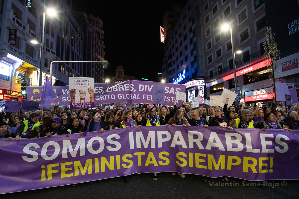 """Madrid, Spain. 8th March, 2019. Demonstrator carrying the main banner of the demonstration with the moto 'We are unstoppable, feminist always"""" during the demonstration held in Madrid during the celebrations of the International Women's Day. © Valentin Sama-Rojo"""