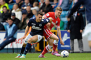 Lee Gregory of Millwall competes with Craig Noone of Cardiff City. Skybet football league championship match , Millwall v Cardiff city at the Den in Millwall, London on Saturday 25th October 2014.<br /> pic by John Patrick Fletcher, Andrew Orchard sports photography.