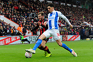 Ryan Fraser (24) of AFC Bournemouth battles for possession with Leon Balogun (14) of Brighton and Hove Albion during the The FA Cup 3rd round match between Bournemouth and Brighton and Hove Albion at the Vitality Stadium, Bournemouth, England on 5 January 2019.