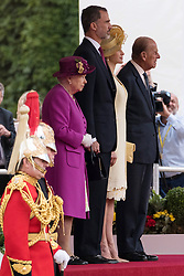 © Licensed to London News Pictures. 12/07/2017. London, UK. QUEEN ELIZABETH II, HIS MAJESTY KING FELIPE VI OF SPAIN, HER MAJESTY QUEEN LETIZIA, and the DUKE OF EDINBURGH attends the Ceremonial Welcome at Horse Guards Parade during a three day State visit. Photo credit: Ray Tang/LNP