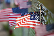 Flags stuck  on a fance at  Flight 93 National Memorial site's temporary memorial  overlooking the field where the flight crashed in Shanksville Pennsylvania. The temporary site will close on Sept. 9th at 4 P.M. and on Sept. 10 the official memorial will open in time for the 10th anniversary of 9/11