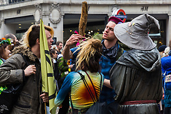 Activists discuss the merits of a man's stick as hundreds of environmental protesters from Extinction Rebellion occupy Oxford Circus, a pink yacht being the focal point of their presence, with traffic denied access to two of London's busiest streets. London, April 16 2019.