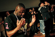 Artists are praying on stage during the final moments on stage of the 'Palestine - The Album', a music collection recorded by many different artists in the Islamic Hip Hop scene in London, England, on Saturday, Jan. 6, 2007.  Islamic Hip Hop artists like the duo 'Blind Alphabetz', from London, feel more than ever the need to say what they think aloud. In the music industry the backlash of a disputable Western foreign policy towards Islamic countries and its people is strong. The number of artists in the European Union and the US taking this into consideration and addressing the current social and political problems within their lyrics is growing rapidly and fostering awareness for Muslim and others alike.