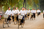 15 MARCH 2006 - PEAM CHIHYKAUNG, KAMPONG CHAM, CAMBODIA: High school students ride their bikes home after class in Peam Chihykaung in central Cambodia. Photo by Jack Kurtz