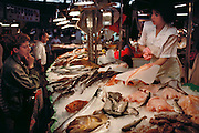 Fish vendor in the Mercado del Ninot, Barcelona, Spain.