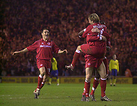 Photo. Glyn Thomas.<br /> Middlesbrough v Arsenal. Carling Cup semi final second leg. <br /> Riverside Stadium, Middlesbrough. 03/02/2004.<br /> Boro's Stuart Parnaby is congratulated by teammates Gaizka Mendieta (R) and Doriva (L) as his goal puts his side in the final.