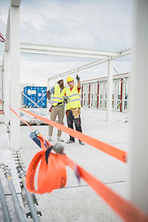 Construction workers discussing at construction site, Munich, Bavaria, Germany, Europe