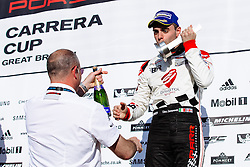 Dino Zamparelli celebrates a 2nd place finish in Race 2 and Driver of the Weekend award after his earlier Race 1 win | Bristol Sport Racing | #88 Porsche 911 GT3 Cup Car | Porsche Carrera Cup GB | Race 2 - Mandatory byline: Rogan Thomson/JMP - 07966 386802 - 27/09/2015 - MOTORSPORT - Silverstone Circuit - Towcester, England - BTCC Meeting Day 2.