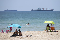 June 16, 2018 - Ashdod, Israel, Israel - Israelis cool off on the beach as a heat wave hits the port town of Ashdod, Israel on June 16, 2018. Ashdod, a popular beach town with the largest port in Israel, is also the sixth largest city in Israel. (Credit Image: © Ronen Tivony/NurPhoto via ZUMA Press)