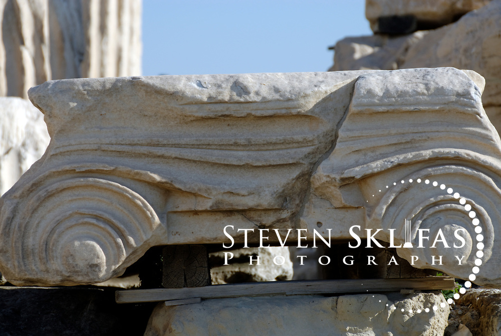 Acropolis. Athens. Greece. Close detailed view of an elegant ancient Ionic capital stored on the ground at the Acropolis. The Acropolis of Athens and its monuments are a UNESCO World Heritage Site.