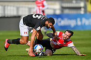 Ryan Bowman (12) of Exeter City and Leyton Orient Jamie Turley (23) battles for possession  during the EFL Sky Bet League 2 match between Exeter City and Leyton Orient at St James' Park, Exeter, England on 6 March 2021.