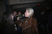 Bettina Allla Moda and Bridgetta Wernebuurg. ( Edotor of Taz Art mag) rieze Party Berlin. Stadtbad, Oderberger Strasse 57-59, Oderberger Strasse. Berlin. 23 March 2006. ONE TIME USE ONLY - DO NOT ARCHIVE  © Copyright Photograph by Dafydd Jones 66 Stockwell Park Rd. London SW9 0DA Tel 020 7733 0108 www.dafjones.com