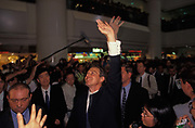 British Prime Minister Tony Blair greets crowds in the Pacific shopping mall on the eve of the handover of sovereignty from Britain to China, on 30th June 1997, in Hong Kong, China. Blair accompanied the outgoing Governor, Chris Patten on the walkabout around parts of the still-British colony. Midnight signified the end of British rule, and the transfer of legal and financial authority back to China. Hong Kong was once known as fragrant harbour or Heung Keung because of the smell of transported sandal wood.