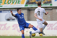 Peterhead's Ryan Conroy (3) and Cove Rangers' Blair Yule (8) battles for possession, tussles, tackles, challenges, during the Premier Sports Scottish League Cup match between Peterhead and Cove Rangers at Balmoor, Peterhead, Scotland on 17 July 2021.