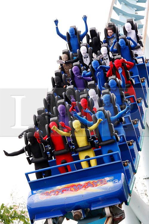 """© licensed to London News Pictures. Tamworth/Staffordshire, UK  07/05/2011. Morphsuit challenge to break the Guiness World Record at Drayton Manor Park, Tamworth, Staffs. Pictured, Morphs take a ride on the """"Shock Wave"""" ride. Please see special instructions for usage rates. Photo credit should read Dave Warren/LNP"""