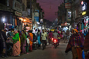 Busy market at the cool of dusk on 21st February 2018 in Jodhpur, Rajasthan, India. Popularly known as the Blue City, Jodhpur is a city in the Thar Desert of the northwest Indian state of Rajasthan. Jodhpur is the Handicraft Hub of India.