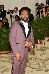 Donald Glover attending the Costume Institute Benefit at The Metropolitan Museum of Art celebrating the opening of Heavenly Bodies: Fashion and the Catholic Imagination. The Metropolitan Museum of Art, New York City, New York, May 7, 2018. Photo by Lionel Hahn/ABACAPRESS.COM