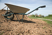 wheelbarrow at a heap with wood chips