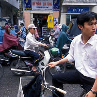 Asia, Vietnam, Hanoi, Bicycle traffic in streets along West Lake (Ho Tay) in city's downtown
