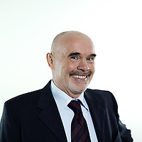 studio portrait isolated on white background of a smiling man senior