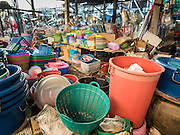 30 DECEMBER 2015 - BANGKOK, THAILAND:  Housewares for sale in Bang Chak Market. The market is supposed to close permanently on Dec 31, 2015. The Bang Chak Market serves the community around Sois 91-97 on Sukhumvit Road in the Bangkok suburbs. About half of the market has been torn down. Bangkok city authorities put up notices in late November that the market would be closed by January 1, 2016 and redevelopment would start shortly after that. Market vendors said condominiums are being built on the land.           PHOTO BY JACK KURTZ