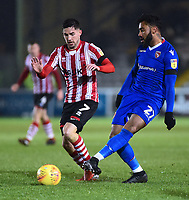 Lincoln City's Tom Pett battles with Morecambe's Jordan Cranston<br /> <br /> Photographer Andrew Vaughan/CameraSport<br /> <br /> The EFL Sky Bet League Two - Saturday 15th December 2018 - Lincoln City v Morecambe - Sincil Bank - Lincoln<br /> <br /> World Copyright © 2018 CameraSport. All rights reserved. 43 Linden Ave. Countesthorpe. Leicester. England. LE8 5PG - Tel: +44 (0) 116 277 4147 - admin@camerasport.com - www.camerasport.com