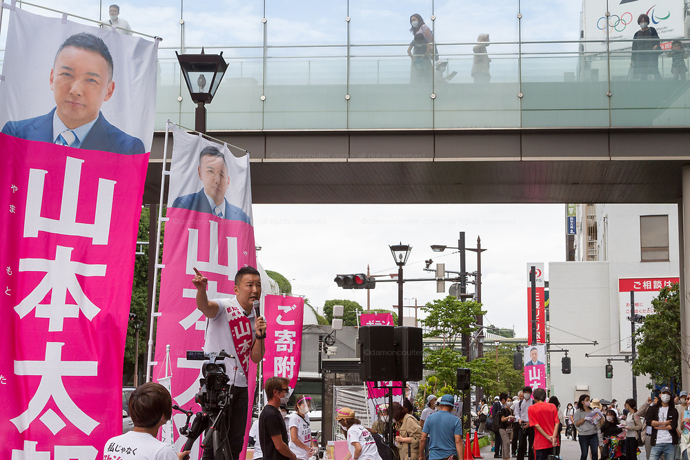 Taro Yamamoto, a former actor and politician, campaigns for election as the Tokyo Governor in Futaka tamagawa, Tokyo, Japan. Tuesday June 23rd 2020. The incumbent  governor, Yuriko Koike (not pictured) is expected to be reelected when the election are held on Sunday July 5th 2020