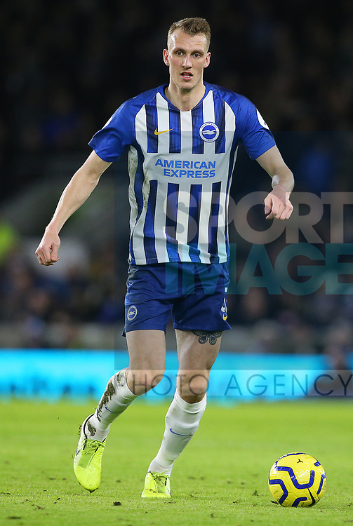 Brighton's Dan Burn during the Premier League match at the American Express Community Stadium, Brighton and Hove. Picture date: 8th February 2020. Picture credit should read: Paul Terry/Sportimage