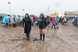 © Licensed to London News Pictures. 26/06/2015. Pilton, UK.  Rain and mud at Glastonbury Festival 2015 on Friday Day 3 of the festival.  This years headline acts include Kanye West, The Who and Florence and the Machine, the latter being upgraded in the bill to replace original headline act Foo Fighters.   Photo credit: Richard Isaac/LNP