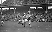 Down player tries to kick the ball clear while Kerry player tackles him during the All Ireland Senior Gaelic Football Final Kerry v Down in Croke Park on the 22nd September 1968. Down 2-12 Kerry 1-13.