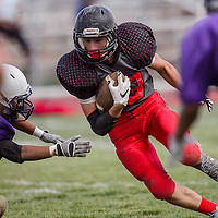 Grants Pirate Cody Dolen (83) weaves through the Kirtland Central Broncos defense during a scrimmage at Grants High School Thursday.