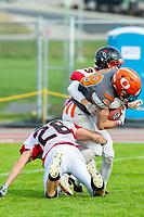 KELOWNA, BC - OCTOBER 6: Blake Johnson #23 of the VI Raiders tackles Kelton Kouri #38 of Okanagan Sun as he runs with the ball at the Apple Bowl on October 6, 2019 in Kelowna, Canada. (Photo by Marissa Baecker/Shoot the Breeze)