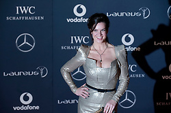 © Licensed to London News Pictures. 06/02/2012. London, UK. Katarina Witt  arriving on the red carpet for the Laureus World Sports Awards 2012. Dozens of sports and Hollywood celebrities arrived in the English capital to attend the event held at the Queen Elizabeth II Conference Centre in the same year that London will host the Olympic Games. Photo credit : Ben Cawthra/LNP