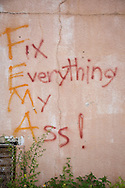Graffiti on the wall of CLub Desire destroyed by Hurricane Katrina in New Orleans.