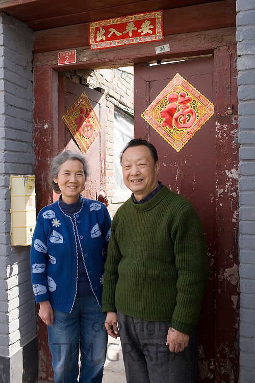 Mr and Mrs Wu outside their home in the Hutongs area, Beijing, China