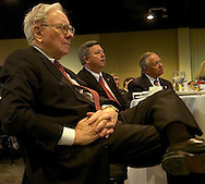2/6/07 Omaha NE Warren Buffett sits next to Nebraska Governor Dave Heinemen (center) and Omaha Mayor Mike Fahey while they listen to Federal Reserve Chairman Ben Bernanke speak at  the Greater Omaha Chamber of Commerce's annual meeting at the Qwest Center Omaha Tuesday afternoon. (photo by Chris Machian/ Bloomberg News)