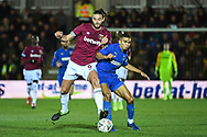 West Ham United forward Andy Carroll (9) and Wimbledon defender Tennai Watson (2) battle for the ball during the The FA Cup fourth round match between AFC Wimbledon and West Ham United at the Cherry Red Records Stadium, Kingston, England on 26 January 2019.