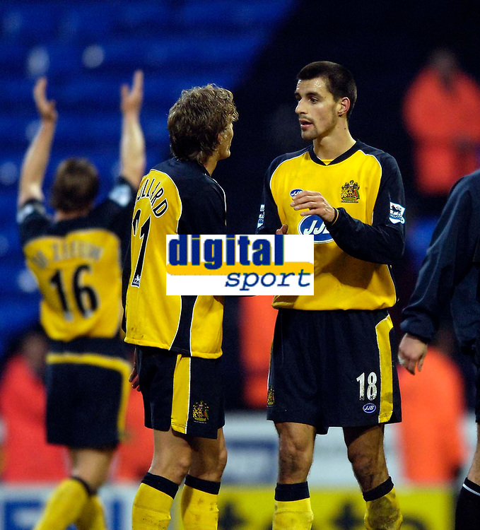 Photo: Jed Wee.<br />Bolton Wanderers v Wigan Athletic. The FA Barclaycard Premiership. 04/02/2006.<br />Bolton's Paul Scharner (R) congratulates Jimmy Bullard at the end of the match.