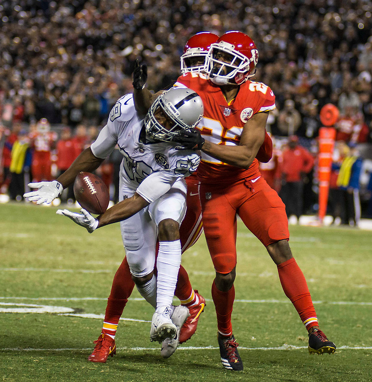 Oct 19 2017 - Oakland CA, U.S.A  Raiders wide receiver Amari Cooper (89) game stats 11 catches for 210 yards and 2 touchdowns tries to catch a deep pass between two Chief defender during the NFL football game between Kansas City Chiefs and the Oakland Raiders 31-30 win at O.co Coliseum Stadium Oakland Calif. Thurman James / CSM
