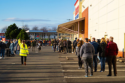 Glasgow, Scotland, UK. 19 November 2020. On the day before the highest level 4 lockdown is imposed on west and central Scotland shops are busy with members of the public out in force. Pictured; Cosco superstore in Glasgow has long queues forming outside. Public are buying Christmas shopping and lots of rolls of toilet paper. Iain Masterton/Alamy Live News