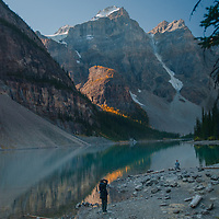 A photographer frames Mounts Babel, Bowlen & Tonsa above Moraine Lake and The Valley of the Ten Peaks in Banff National Park, Alberta, Canada.