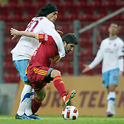 Galatasaray's Sabri SARIOGLU (R) and Trabzonspor's Gustavo COLMAN (L) during their Turkish superleague soccer derby match Galatasaray between Trabzonspor at the TT Arena in Istanbul Turkey on Sunday, 10 April 2011. Photo by TURKPIX